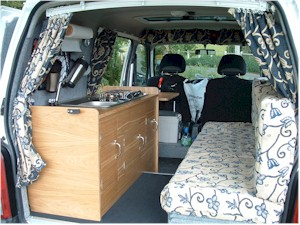 View of the campervan conversion from the back showing the seating - click for the full size image (opens in a new window)