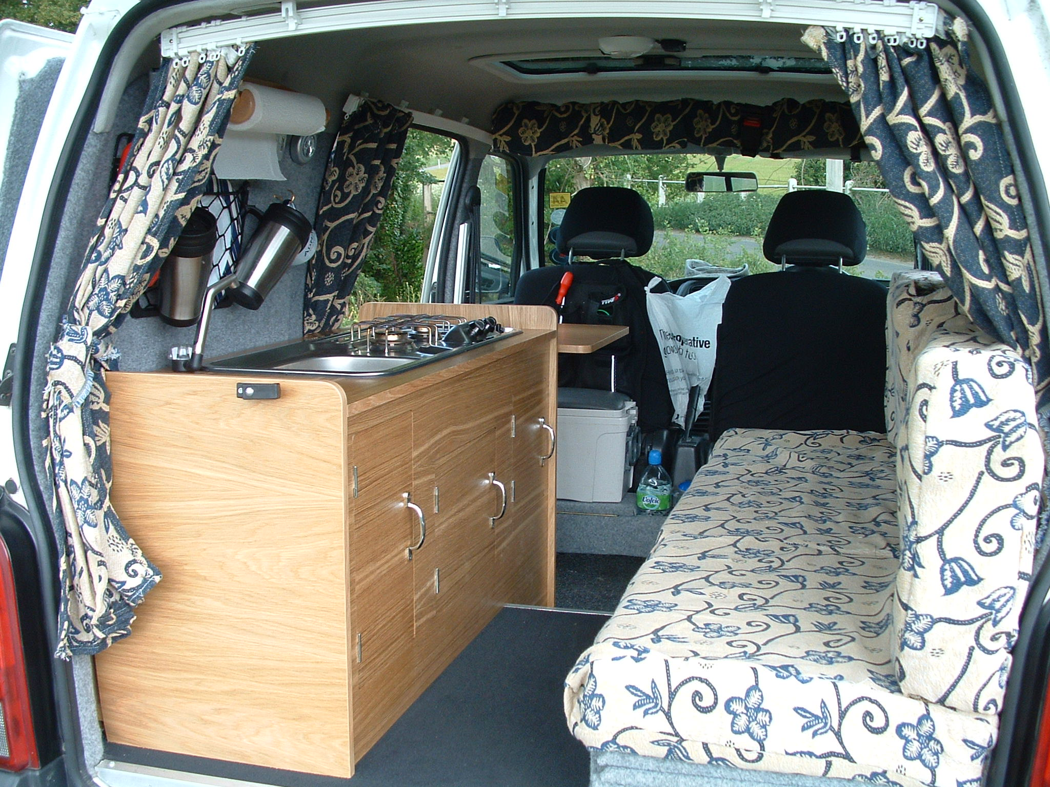 View Of The Campervan Conversion From Back Showing Seating